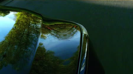 pneu : Black car on the country road - focus on hood - nice reflections