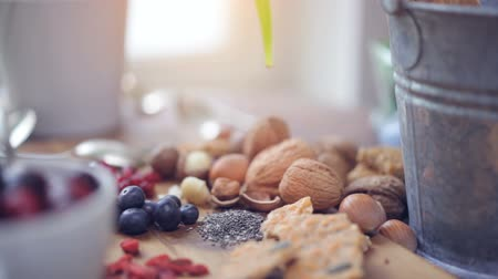 organic : Super Food: variation of healthy superfoods on wooden background. smooth tracking shot, dolly shot Stock Footage