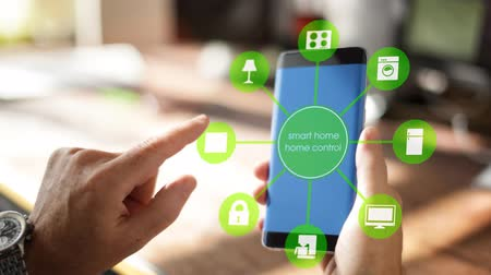 chytrý : Smart Home Device - House automation home Control concept on smartphone using an app for room heating Dostupné videozáznamy
