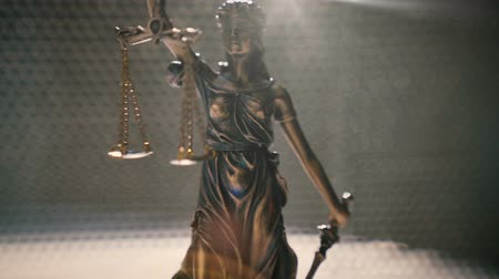 condemn : the statue of justice - justice lady or Iustitia the Roman goddess of Justice, smooth dolly shot with nice lens flares