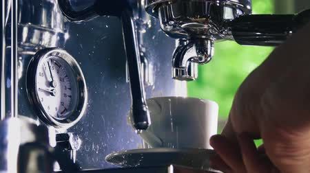 suporte : Espresso pouring from classic coffee into small white cup. Close-up shot. Stock Footage
