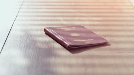 иммиграция : Travel Passport background concept footage. The European Passport on a wooden desktop Стоковые видеозаписи