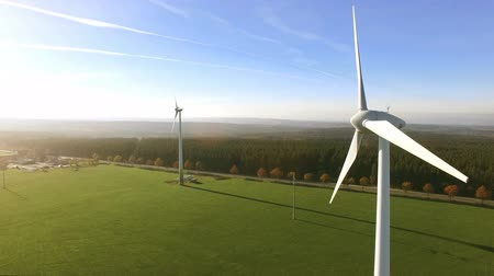 tvořit : Wind Turbines and Agricultural Fields on a Summer Day - Energy Production with Clean and Renewable Energy - aerial shot