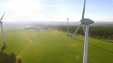 malom : Wind Turbines and Agricultural Fields on a Summer Day - Energy Production with Clean and Renewable Energy - aerial shot