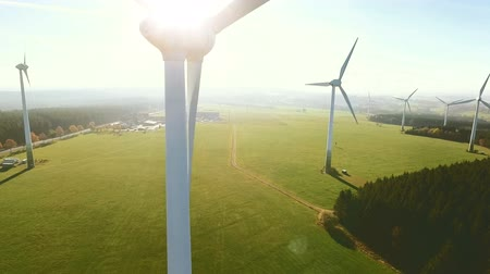 Wind Turbines and Agricultural Fields on a Summer Day - Energy Production with Clean and Renewable Energy - aerial shot