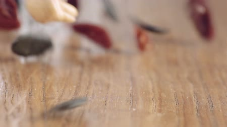 Mixed Superfood Slow Motion on wooden table, close up