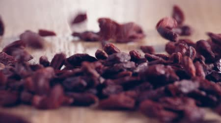 Bunch of Goji Berries authentic slow motion on wooden table, close up