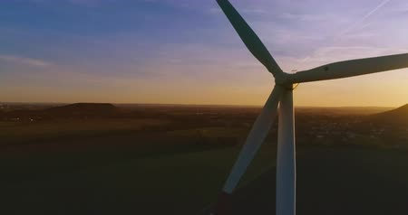 clean electricity production : AERIAL 4K  Ultra HD - Birds eye view on Wind Power, Turbine, Windmill, Energy Production at sunrise or sunrise - Clean and Renewable Energy