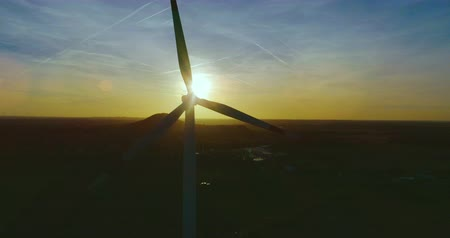 AERIAL 4K  Ultra HD - Birds eye view on Wind Power, Turbine, Windmill, Energy Production at sunrise or sunrise - Clean and Renewable Energy