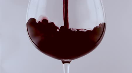 copinho : pouring red wine in a glass in slow motion