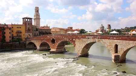 tourism : Ponte Pietra bridge, Ancient Roman Bridge in Verona, Italy Stock Footage