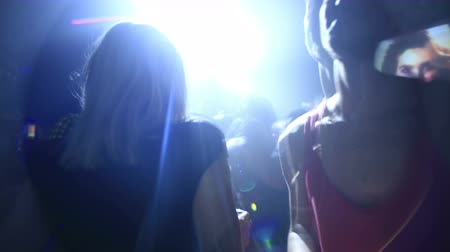 dizi : Image sequence of people dancing and standing around the bar at a night club in London. 4K Stok Video