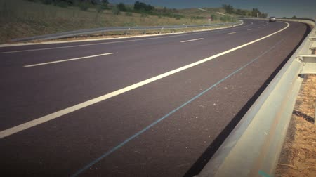 křivky : A vehicle passing on a curve at a highway. HD