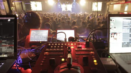 electro : Wide shot of vjs mixers and dance floor. Stock Footage