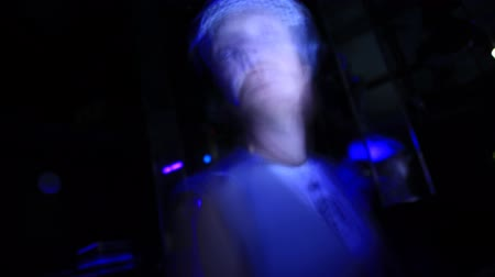 vadon : Blur motion time lapse of a dj playing music at a disco club.