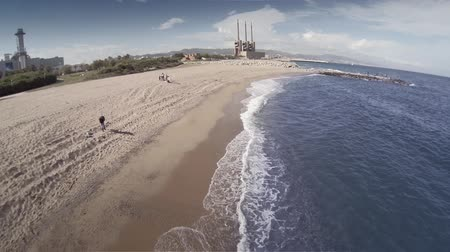 Барселона : Aerial view of the coast of Barcelona and thermal power station in Sant Adria del Besos, Spain. HD Стоковые видеозаписи