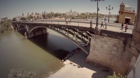 popularly : Great aerial shot of Isabel IIs bridge popularly known as bridge of Triana. Seville, Spain. Great natural light in a sunny day. HD