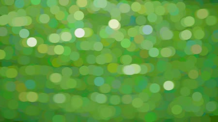 This is footage of green nature seen out of focus through a window. This is the kind of thing you would see if you looked through a half open shutter with holes in it. Very abstract background footage. Colors green and white.