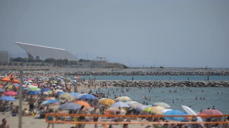This is footage of a very crowded beach in Spain during high season of beach and sea.