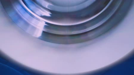 This is footage of a compact disc or CD rotating inside a home stereo player for a long time. Стоковые видеозаписи