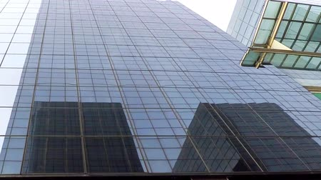 This is footage of a glass office building downtown near all the high-rise and department stores.