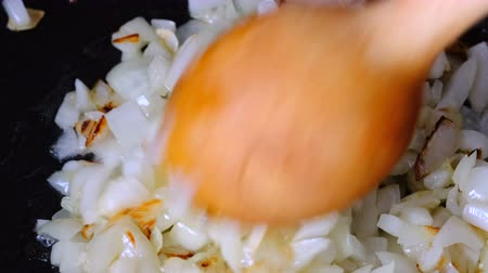 White onion sliced into small pieces, passed with olive oil Stock Footage