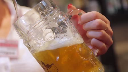 beer tap : beer poured into a mug