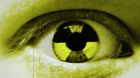 atomový : Radiation sign in eye. Stylized motion. Dostupné videozáznamy