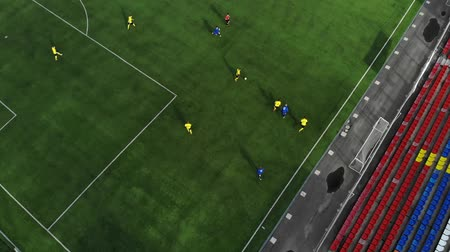 match : Aerial football match play. Clip. Aerial shot Two teams playing ball in football outdoors, top view. Football game outdoors, green field with markings, players running around with a ball