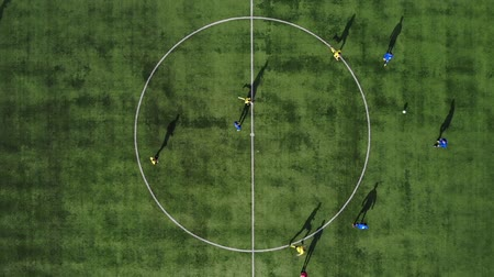 soccer field : Aerial football match start. Beginning of game. Aerial shot Two teams playing ball in football outdoors, top view. Football game outdoors, green field with markings, players running around with a ball