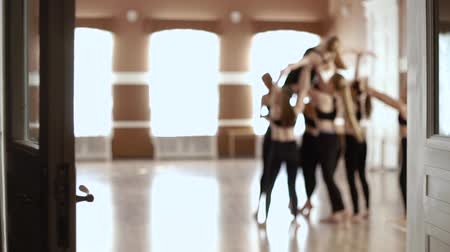 rajstopy : Girls to dance class. Girls in black clothes dancing in the dance hall. Slow motion