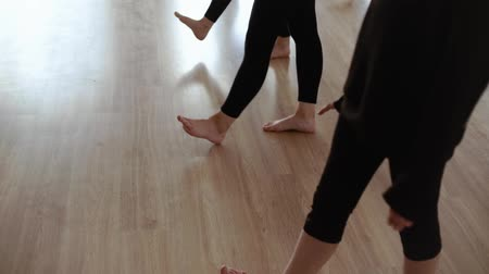 rajstopy : Girls to dance class. Girls in black clothes dancing in the dance hall. Girls warm up before dancing. Close-up legs. Slow motion Wideo