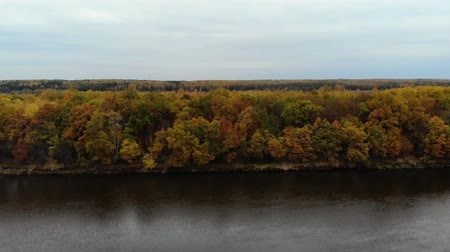 beatiful : Aerial view. Flying over the river. Beautiful autumn day. The camera flies across the river to the other side. 4k Stock Footage