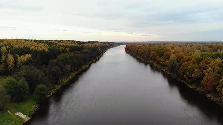 beatiful : Aerial view. Flying over the river. Beautiful autumn day. The camera flies up above the water surface. 4k