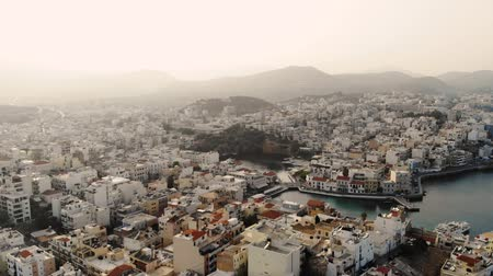 slum house : Aerial view of city Agios Nikolaos on a cloudy day. 4K