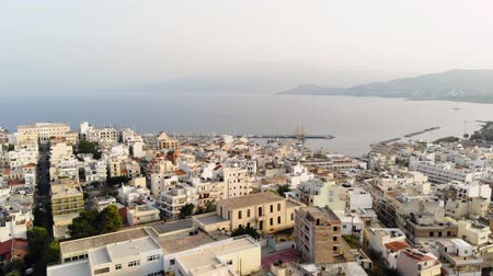 slum house : Aerial view of city Agios Nikolaos on a cloudy day. City by the sea. 4K Stock Footage