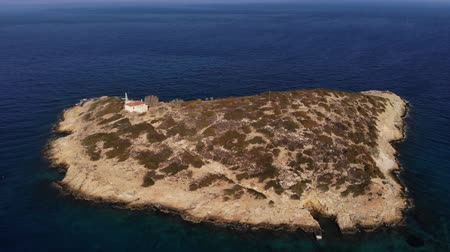crete : Copter fly around the small island with old house surrounded by sea space. Island with one house. Loneliness. Aerial view. 4K