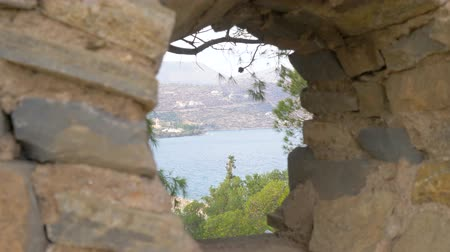 colonial : Sea view through a hole in the wall. 4K Stock Footage
