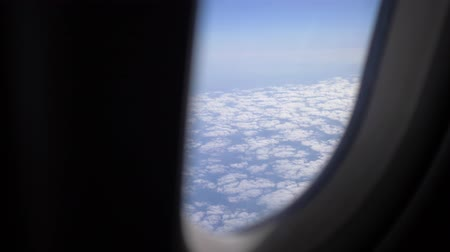 tempo : View from the airplane to the clouds. Passenger aircraft aviation airlines flying traveling business. Hitting the camera. 4K Vídeos