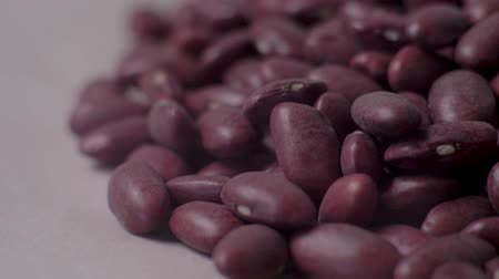 andy : Beans lie in a pile and crumble. Slow motion. Food video