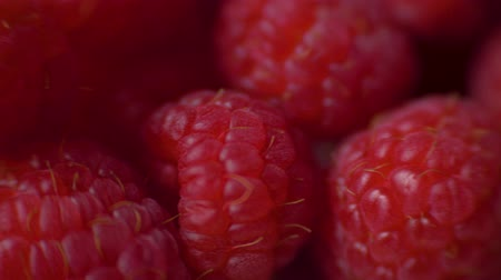rotational : Raspberries super close up 4K stock footage. Raspberries in macro close up with a sliding camera move. Concept: footage for the recipe. Food video Stock Footage