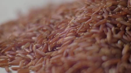 sponka : Raw red rice on the table. Red rice closeup. Concept: footage for the recipe. 4K. Food video Dostupné videozáznamy