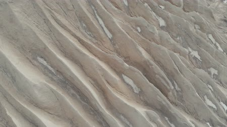 stockpile : Relief of a mining quarry. Barchan. Sand dune. Spent mining quarry. Aerial view 4K