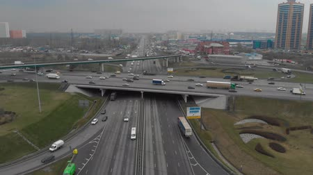 autobahn : Top view of a major road in the city. Top view of the road junction. Moscow, MKAD. The camera flies up to the road junction. Aerial view 4K