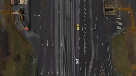 autobahn : Top view of a major road in the city. Top view of the road junction. The camera is dropping over the road. Moscow, MKAD. Aerial view 4K Stock Footage