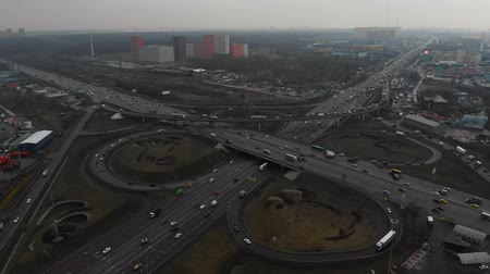 csomópont : Top view of a major road in the city. Top view of the road junction. The camera flies over the road junction. Aerial view 4K