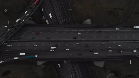 rota : Top view of a major road in the city. Top view of the road junction. The camera is pointed down over the road junction. Aerial view 4K