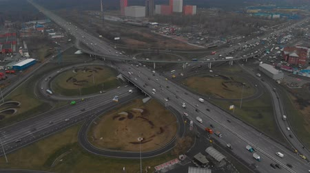 rota : Top view of a major road in the city. Top view of the road junction. The camera is flying over the radius of the road junction. Aerial view 4K