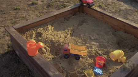 subject : Childrens sandbox with toys lying in it. 4K