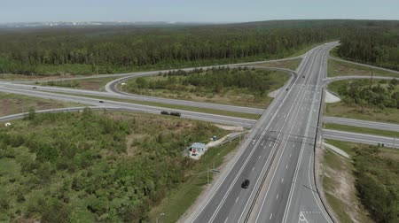 pulling off : Military vehicles are on the side of the road in front of the bridge. Aerial view 4K